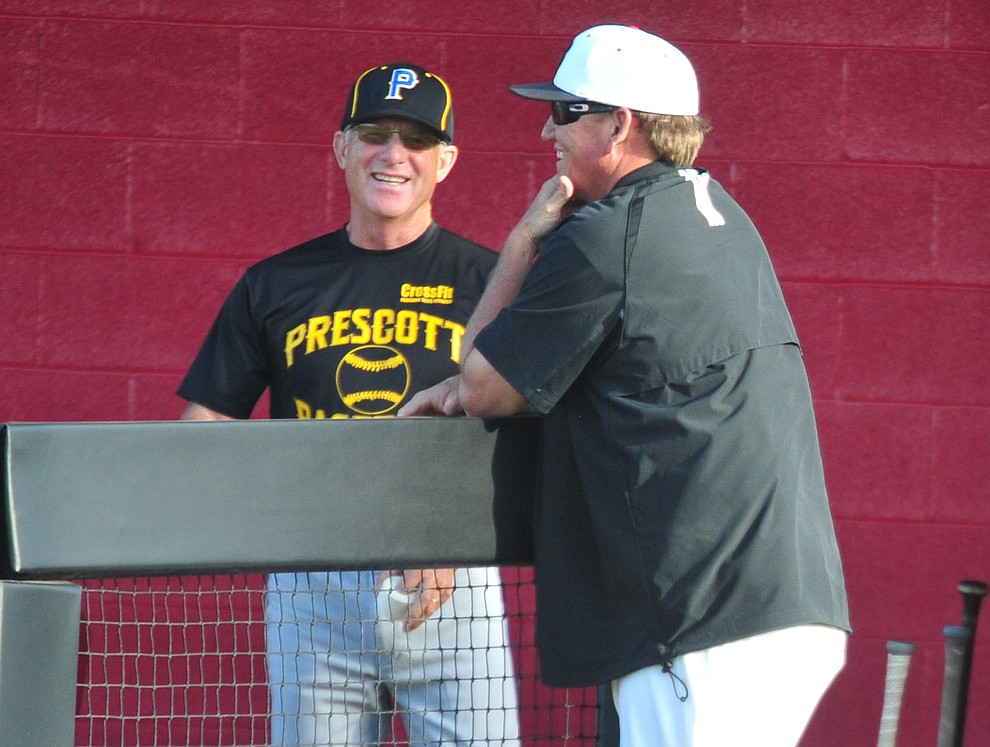 Prescott head coach Kent Winslow and Bradshaw Mountain head coach Brian Bundrick share a laugh before as the Bears take on the Badgers in Prescott Valley Tuesday, April 9.  (Les Stukenberg/Courier)