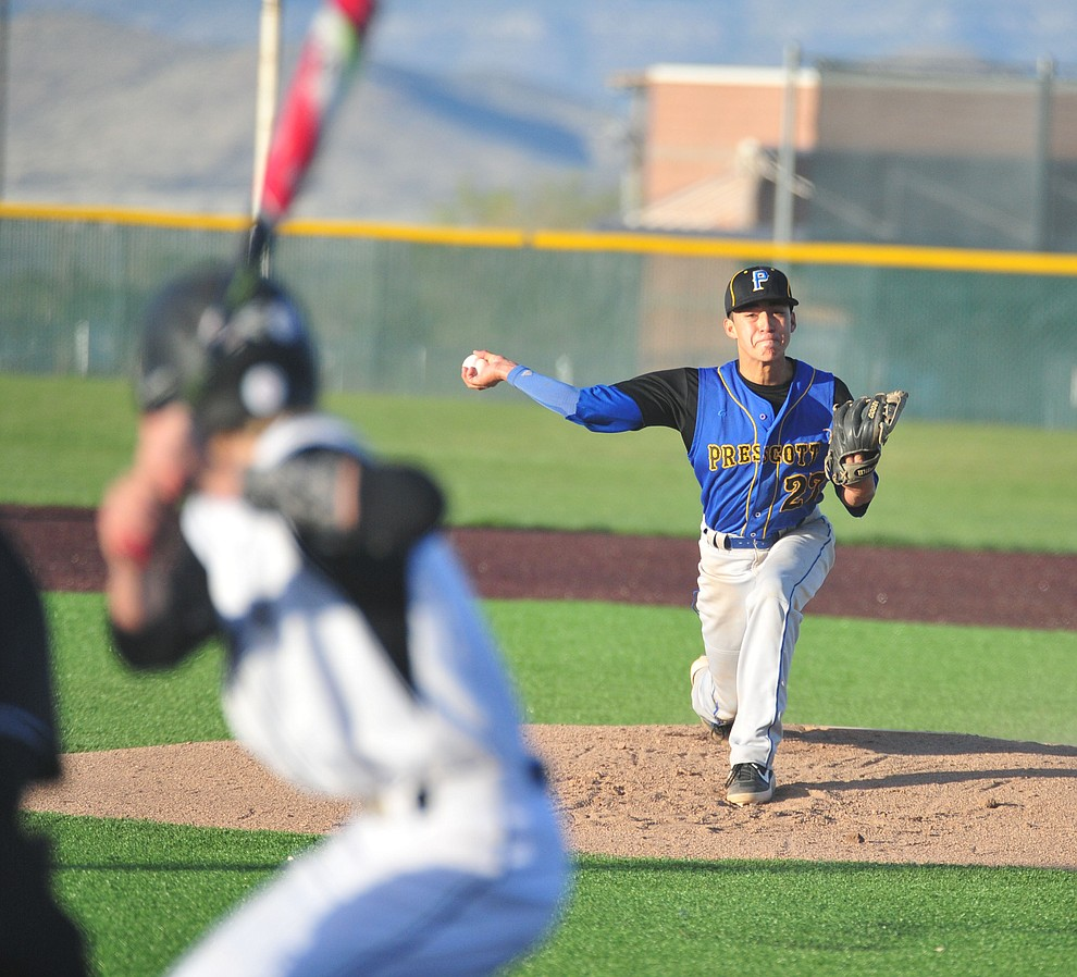 Prescott's Ray Chairez delivers a pitch as the Badgers take on the Bradshaw Mountain Bears in Prescott Valley Tuesday, April 9.  (Les Stukenberg/Courier)