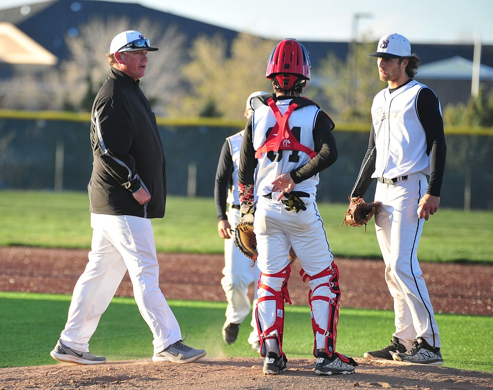 Bradshaw Mountain head coach Brian Bundrick makes a trip to the mound as the Bears take on the Prescott Badgers in Prescott Valley Tuesday, April 9.  (Les Stukenberg/Courier)