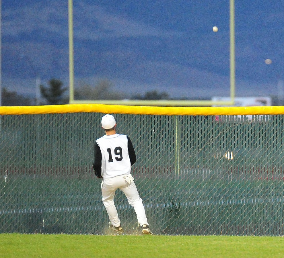 Bradshaw Mountain's Aaron Gordon watches Jake Schulz two-run homer clear the wall as the Bears take on the Prescott Badgers in Prescott Valley Tuesday, April 9.  (Les Stukenberg/Courier)