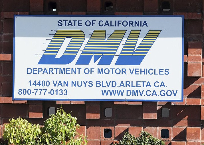 "The California Department of Motor Vehicles office in the Arleta neighborhood of Los Angeles is seen Tuesday, April 9, 2019. A soccer fan claims in a lawsuit that the California DMV violated his First Amendment rights by rejecting a personalized license plate he said would celebrate his favorite team, but which the DMV said might be deemed offensive. The lawsuit says Jon Kotler applied for a plate that would read COYW, an abbreviation of ""Come on You Whites,"" a slogan used by fans of London-based Fulham Football Club, referring to their signature white shirts. (AP Photo/Richard Vogel)"
