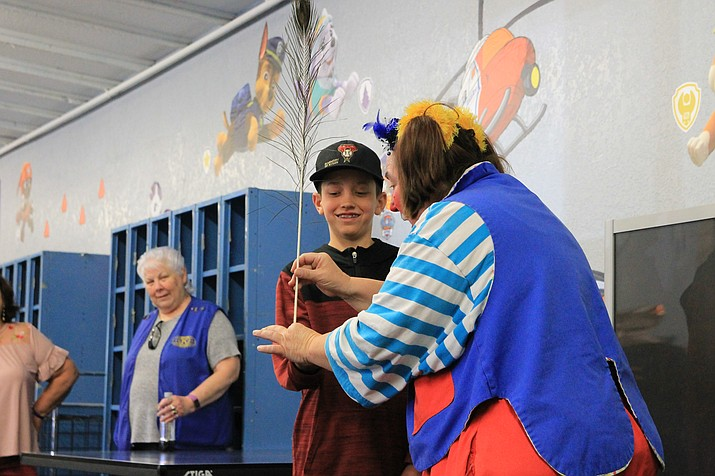 A clown from the Culpepper and Merriweather Circus visits the Williams Rec Center April 5 to give children a preview of the show, which comes to town for one night April 17. (Wendy Howell/WGCN)
