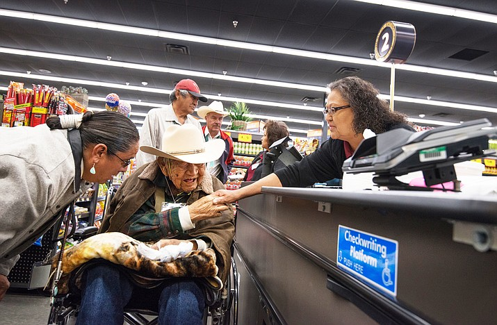 Ram Herder, 100, was the first customer to the new Bashas' Diné Market April 3, in Sanders, Arizona. Herder is a founding member of the Nahata Dziil community and is a relocatee from Coalmine Canyon as a result of the Navajo-Hopi land dispute. (Photo courtesy of Bashas' Family of Stores)