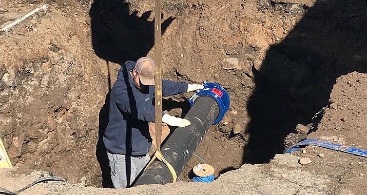 City workers repair a section of the water main that broke in late December 2018 on Marvin Gardens Lane in Prescott's Cliff Rose subdivision. The middle-of-the-night waterline break reportedly caused the loss of about 275,000 gallons of water. (Rita Wuehrmann/Courtesy)