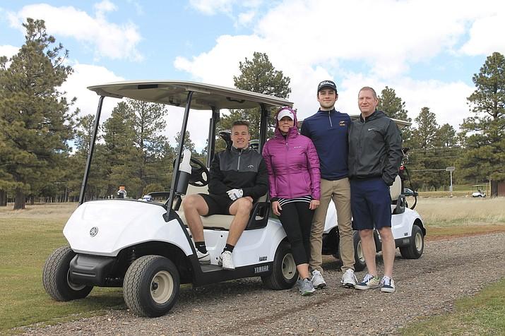 The Lindsley family from Battle Creek, Michigan enjoy a round of golf April 3. (Loretta Yerian/WGCN)