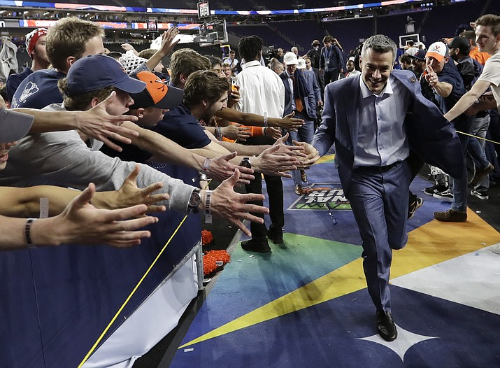 Virginia head coach Tony Bennett celebrates with fans after the championship game against Texas Tech in the Final Four NCAA college basketball tournament, Monday, April 8, 2019, in Minneapolis. Virginia won 85-77 in overtime. (David J. Phillip/AP)