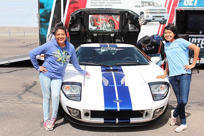 Hopi High students Latifah Huma and Jaeda Honani pose with the car that Nicholas Cage used to drive. (Stan Bindell/NHO)