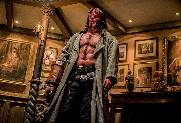 "This image released by Lionsgate shows David Harbour in a scene from ""Hellboy."" (Mark Rogers/Lionsgate via AP)"
