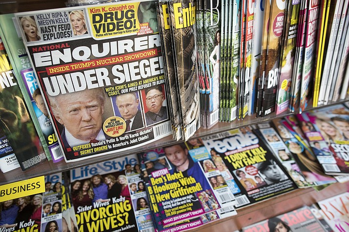 "An issue of the National Enquirer on July 12, 2017, featuring President Donald Trump on its cover at a store in New York. The parent company of the National Enquirer said Wednesday, April 10, 2019, that it is exploring the publication's possible sale as part of a ""strategic review"" of its tabloid business. (Mary Altaffer/AP, File)"