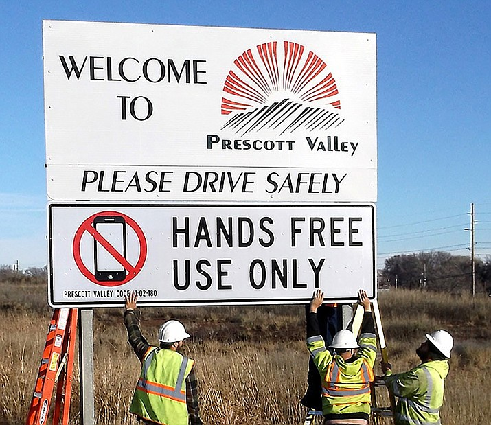 Prescott Valley Public Works crews place a sign in January to remind drivers of the new ban on use of handheld devices while driving. (Town of Prescott Valley/Courtesy)