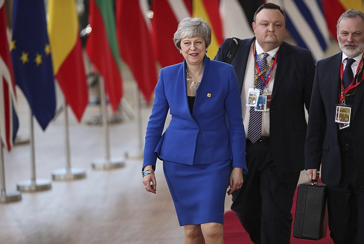 British Prime Minister Theresa May, left, arrives for an EU summit at the Europa building in Brussels, Wednesday, April 10, 2019. European Union leaders meet Wednesday in Brussels for an emergency summit to discuss a new Brexit extension. (Francisco Seco/AP)