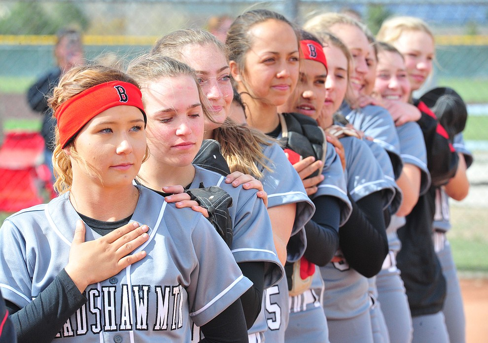 Bradshaw Mountain's players stand for the National Anthem as the Bears host the Prescott Badgers Thursday, April 11 in Prescott Valley.  (Les Stukenberg/Courier)