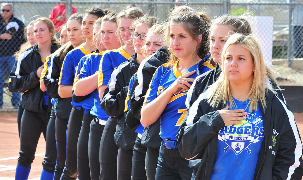 Prescott's players stand for the National Anthem as the Badgers play the Bradshaw Mountain Bears Thursday, April 11 in Prescott Valley.  (Les Stukenberg/Courier)