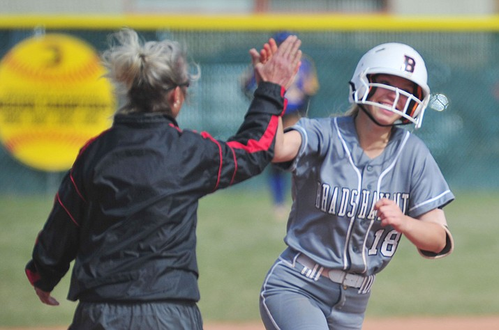Bradshaw Mountain's Kassidy Outlaw gets congratulated by head coach Sharon Haeese after her leadoff home run in the first inning as the Bears host the Prescott Badgers Thursday, April 11 in Prescott Valley.  (Les Stukenberg/Courier)