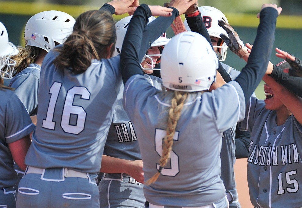 Bradshaw Mountain's Kassidy Outlaw gets congratulated by her team mates after her leadoff home run in the first inning as the Bears host the Prescott Badgers Thursday, April 11 in Prescott Valley.  (Les Stukenberg/Courier)