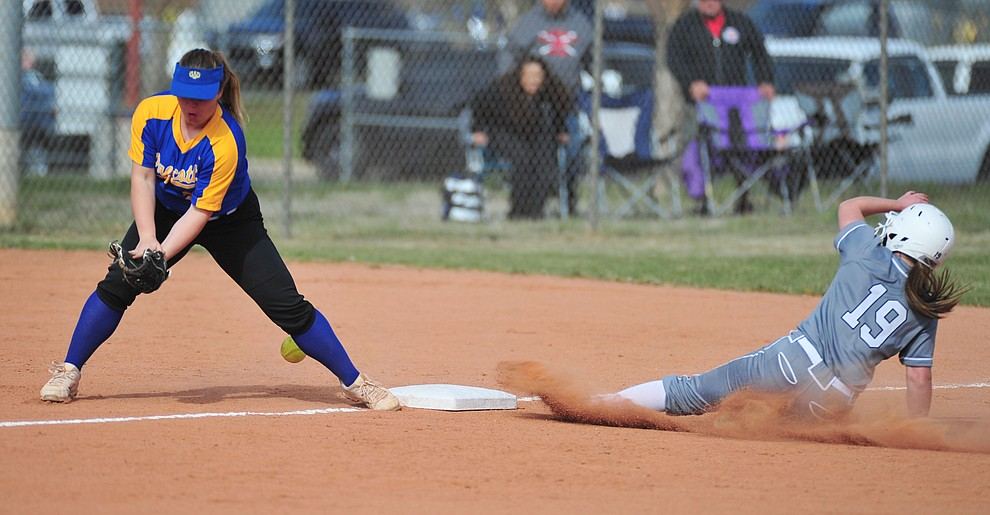 Bradshaw Mountain's Caitlynn Neal slides safely into third on a steal as the Bears host the Prescott Badgers Thursday, April 11 in Prescott Valley.  (Les Stukenberg/Courier)