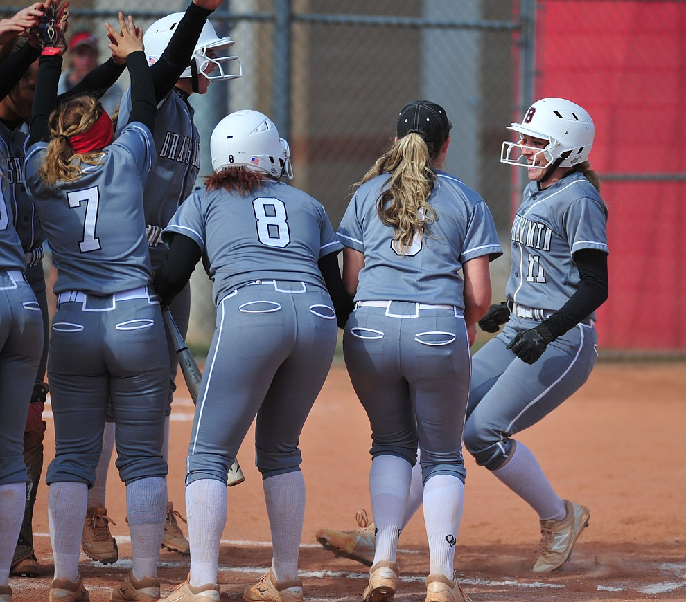 Bradshaw Mountain's Jacie Hambrick gets congratulated by her team mates after stroking a first inning home run as the Bears host the Prescott Badgers Thursday, April 11 in Prescott Valley.  (Les Stukenberg/Courier)