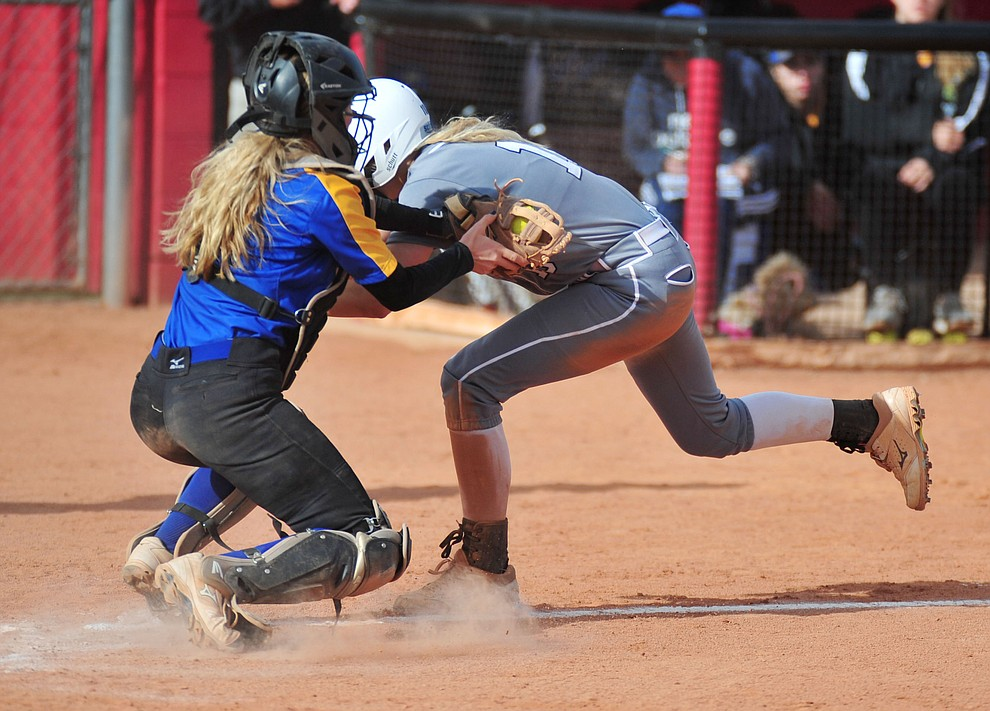 Prescott's Danner Cozens tags Kassidy Outlaw out as the Badgers play the Bradshaw Mountain Bears Thursday, April 11 in Prescott Valley.  (Les Stukenberg/Courier)