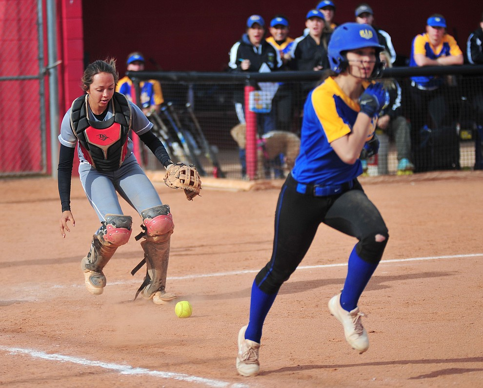 Bradshaw Mountain's Layla Stouder goes for a bunted ball as the Bears host the Prescott Badgers Thursday, April 11 in Prescott Valley.  (Les Stukenberg/Courier)