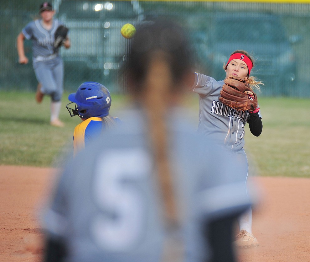 Bradshaw Mountain's Shelby Dilcher tries to turn the double play as the Bears host the Prescott Badgers Thursday, April 11 in Prescott Valley.  (Les Stukenberg/Courier)