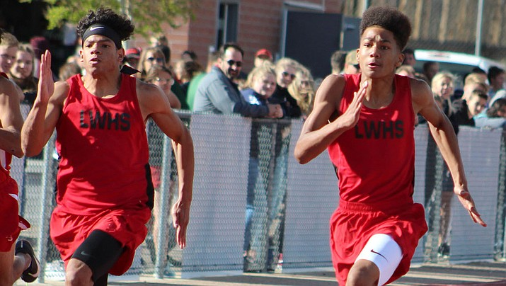 Lee Williams sophomore Kameron Toms, right, narrowly won the 100-meter dash Wednesday with a 11.53, followed by teammate Christion Martinez, center, in second at 11.79. The two also finished first and second in the 200. (Photo by Beau Bearden/Daily Miner)