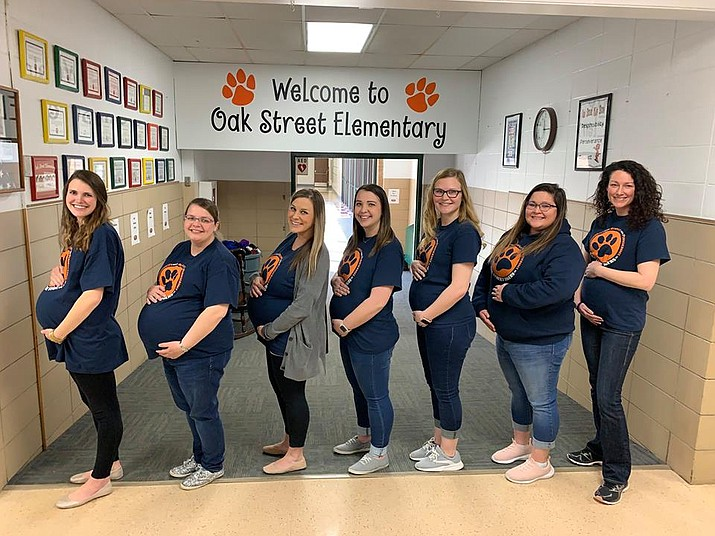 Seven teachers were pregnant at the same time at Oak Street Elementary School in Goddard when the school posted a photo on Facebook last month with the women showing off their bulging bellies. (Oak Street Elementary School)