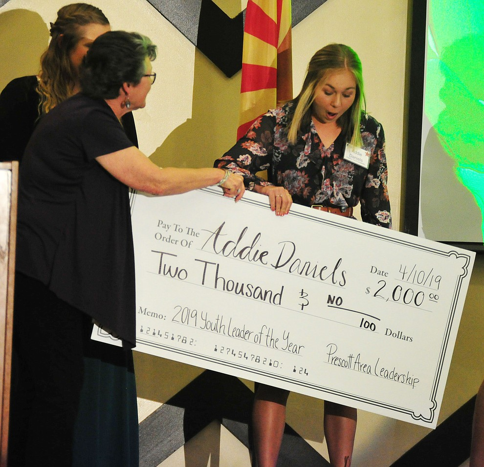 Addie Daniels is awarded a $2,000 scholarship as the Female Youth of the Year at the Prescott Area Leadership 2019 Community Leaders of the Year banquet and awards ceremony Wednesday, April 10 at the Prescott Resort.  (Les Stukenberg/Courier)