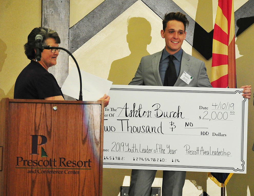 Ashton Burch is awarded a $2,000 scholarship as the Male Youth of the Year at the Prescott Area Leadership 2019 Community Leaders of the Year banquet and awards ceremony Wednesday, April 10 at the Prescott Resort.  (Les Stukenberg/Courier)