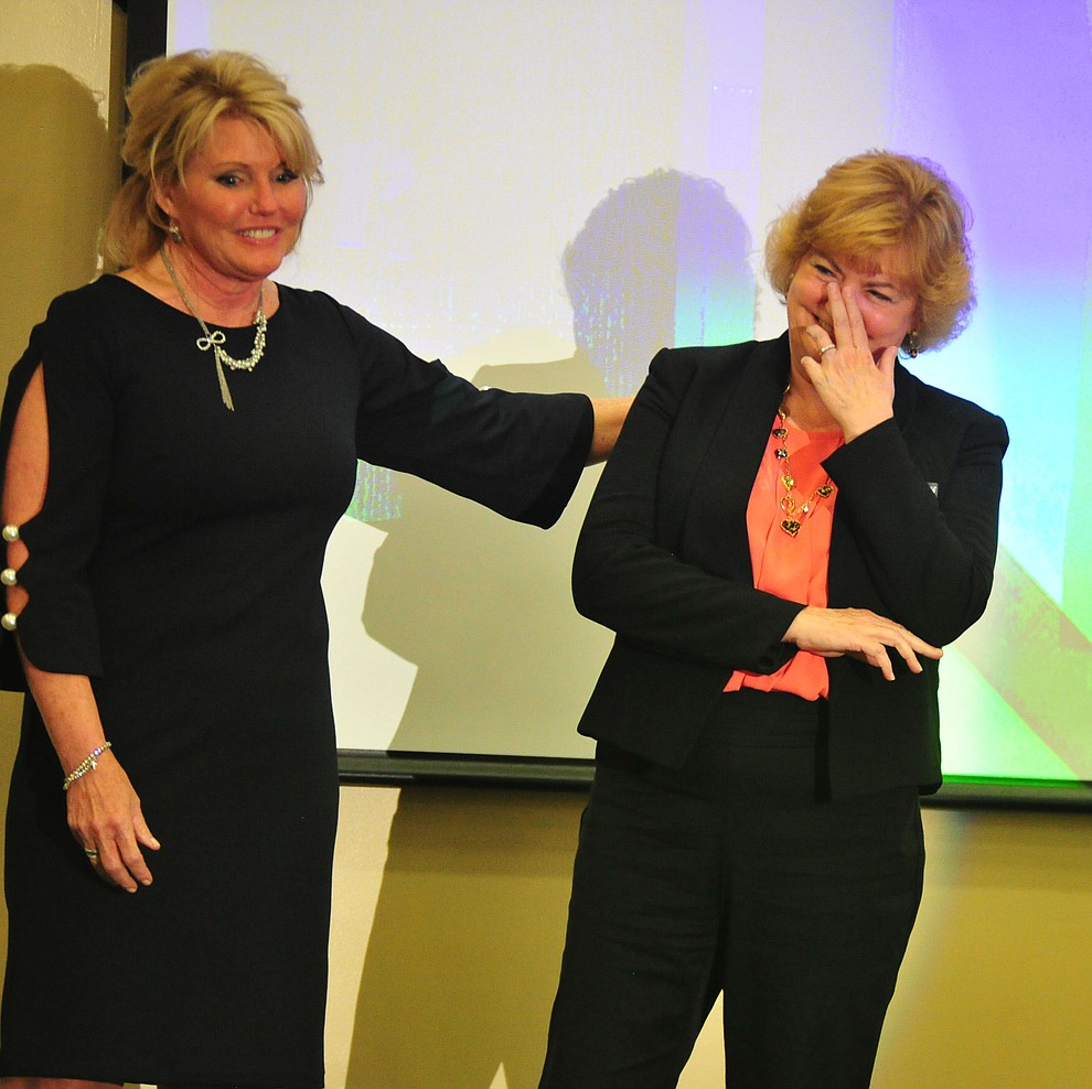 Prescott Police Chief Debora Black congratulates Director of the Prescott Regional Airport Robin Sobotta on being named Woman of the Year at the Prescott Area Leadership 2019 Community Leaders of the Year banquet and awards ceremony Wednesday, April 10 at the Prescott Resort.  (Les Stukenberg/Courier)