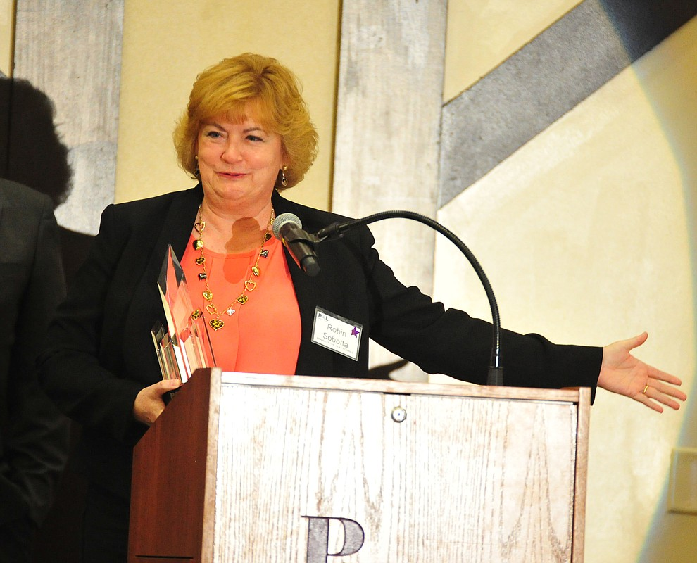Director of the Prescott Regional Airport Robin Sobotta on speaks after being named Woman of the Year at the Prescott Area Leadership 2019 Community Leaders of the Year banquet and awards ceremony Wednesday, April 10 at the Prescott Resort.  (Les Stukenberg/Courier)