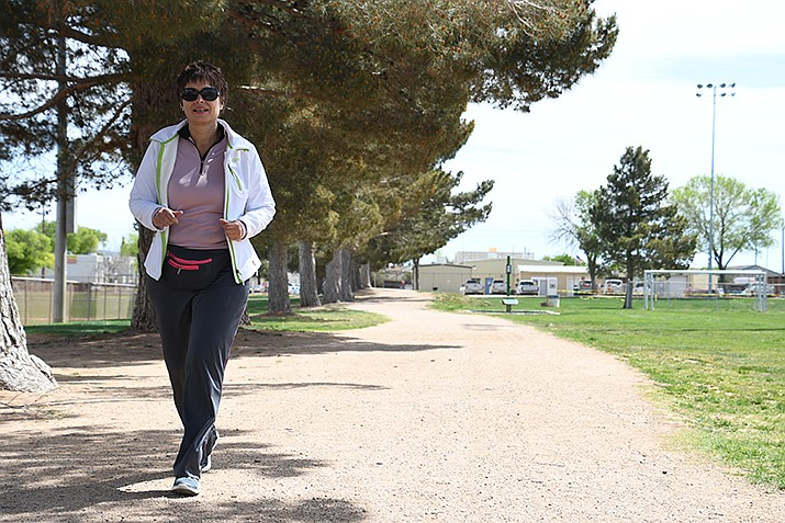 Yvonne Phillips, of Kingman, utilizes the walking path at Centennial Park on Thursday, April 11. Phillips takes walks or jogs every now-and-then to keep a healthy lifestyle. (Photo by Vanessa Espinoza/Daily Miner)