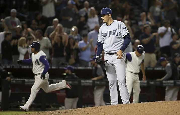 San Diego Padres relief pitcher Brad Wieck, right, pauses on the mound after giving up a three-run home run to Arizona Diamondbacks' Eduardo Escobar, left, during the seventh inning of a baseball game Thursday, April 11, 2019, in Phoenix. The Padres won 7-6. (Ross D. Franklin/AP)