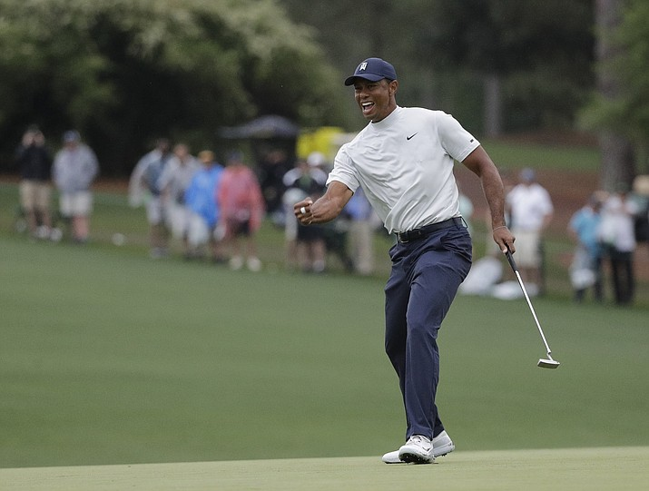 Tiger Woods reacts to his birdie putt on the 15th hole during the second round for the Masters golf tournament Friday, April 12, 2019, in Augusta, Ga. (David J. Phillip/ap)