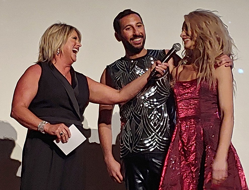 Master of Ceremonies Leza Lachapelle Dandos interviews Veronica Phillips and Zach Leonard following their dance during the 2019 Dancing for the Stars matinee performance Saturday, April 13 at the Elks Theatre in Prescott.  (Sue Tone/Courier)