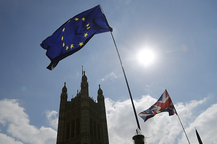 Protestor flags fly opposite the Houses of Parliament in London, Thursday, April 11, 2019. European Union leaders on Thursday offered Britain an extension to Brexit that would allow the country to delay its EU departure date until Oct. 31. (Frank Augstein/AP)