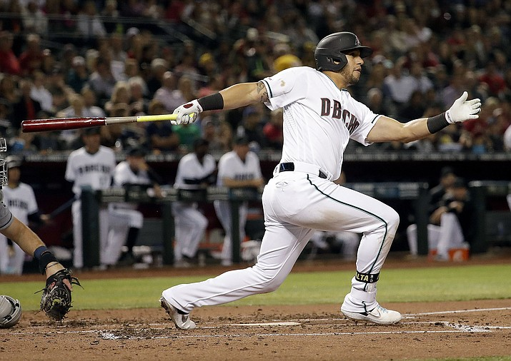 Arizona Diamondbacks' David Peralta follows through on an RBI base hit during the third inning against the San Diego Padres, Friday, April 12, 2019, in Phoenix. (Matt York/AP)