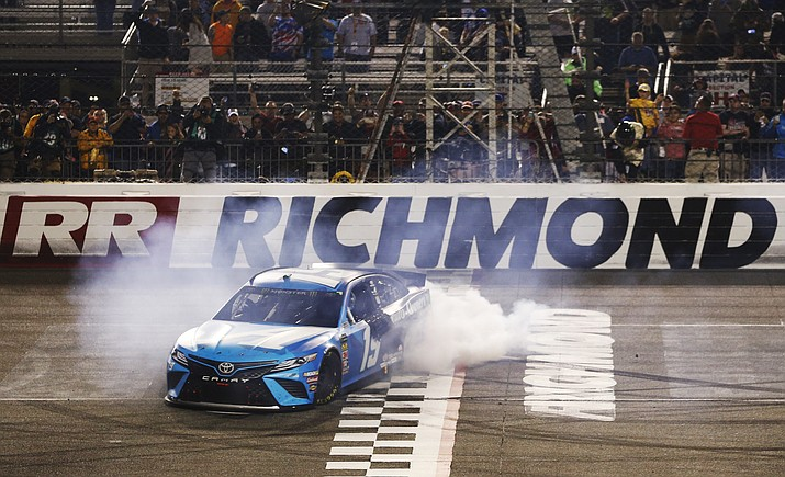 Martin Truex Jr. does a burnout after winning the NASCAR Cup Series race at Richmond Raceway in Richmond, Va., Saturday, April 13, 2019. (Steve Helber/AP)