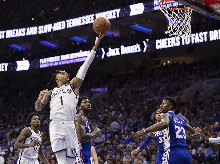 Brooklyn Nets' D'Angelo Russell, left, goes up for the shot as he gets past Philadelphia 76ers' Joel Embiid during the second half in Game 1 of a first-round NBA playoff series, Saturday, April 13, 2019, in Philadelphia. The Nets won 111-102. (Chris Szagola/AP)