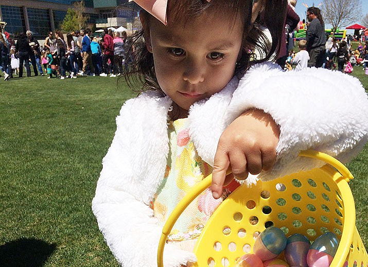 Makaylah Cortes, 4, of Prescott Valley shows off her basket full of colorful plastic eggs