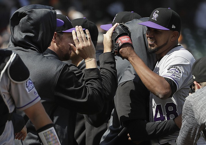 Colorado Rockies pitcher German Marquez, right, celebrates with teammates after they defeated the San Francisco Giants in a baseball game in San Francisco, Sunday, April 14, 2019. (Jeff Chiu/AP)