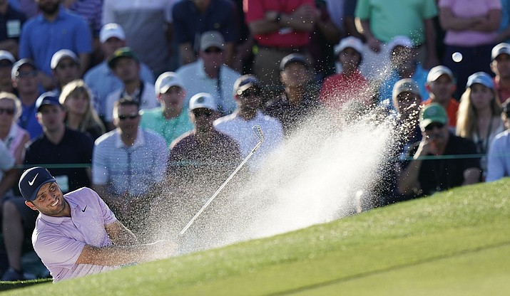 Francesco Molinari, of Italy, hits from a bunker on the 18th hole during the third round for the Masters on Saturday, April 13, 2019, in Augusta, Ga. (David J. Phillip/AP)