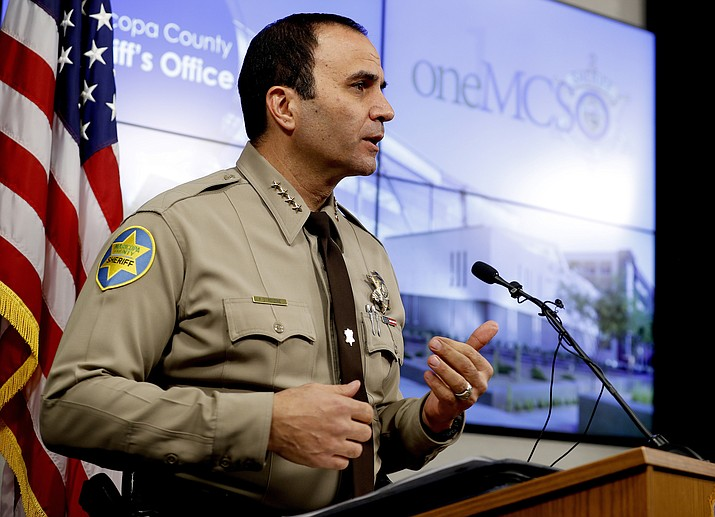 This Feb. 14, 2019, file photo, shows Maricopa County Sheriff Paul Penzone at a news conference in Phoenix. Officers at the sheriff's office in metro Phoenix have made 52% fewer traffic stops in the years since a judge concluded they had racially profiled Latinos in then-Sheriff Joe Arpaio's immigration patrols. Penzone, and others tell The Associated Press that the decrease is driven by officers' fears that they'll be unfairly scrutinized in a court-ordered overhaul that's aimed at ridding the agency of its biased policing. (Matt York/AP, file)
