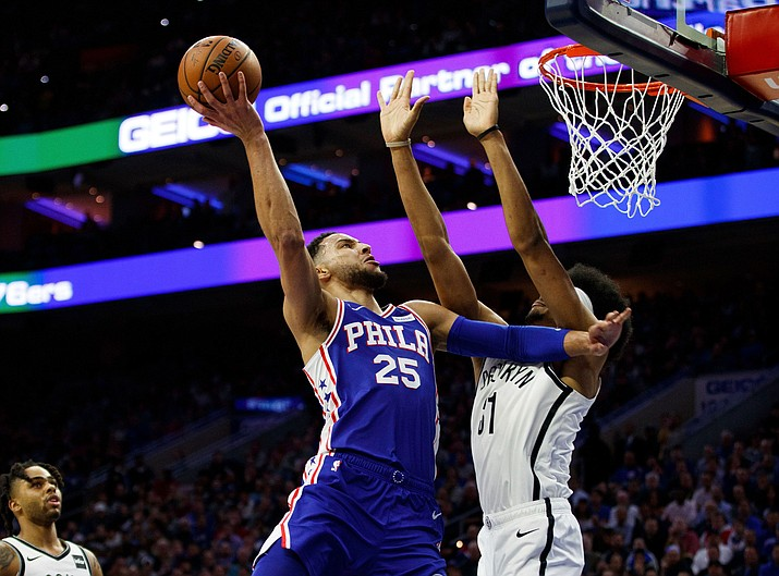 Philadelphia 76ers' Ben Simmons, left, of Australia, goes up for the shot against Brooklyn Nets' Jarrett Allen, right, during the first half in Game 2 of a first-round NBA basketball playoff series, Monday, April 15, 2019, in Philadelphia. (Chris Szagola/AP)