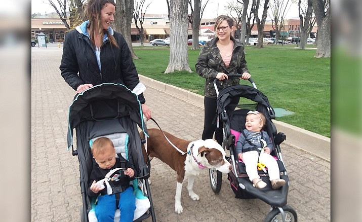 Jessica Ruttle and Adrian walk at the square with Miya accompanied by best friends, Lindsey Saiz and Harper. (Courtesy)