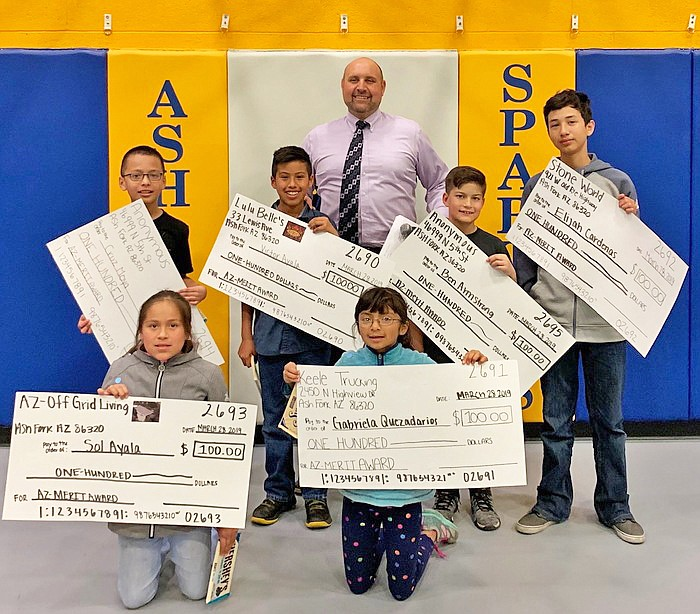 Ash Fork students received $100 for achieving a perfect score on the AzMerit in 2018. Lulu Belle's, Stone World, Az-Off Grid Living, Keele Trucking and other donors donated funding to students for their achievements. The outstanding students include clockwise from bottom left: Sol Ayala, Cruz Moya, Victor Ayala, Ben Armstrong, Elijah Cardenas and Gabriela Quezadarios. (Photo/Ash Fork School)