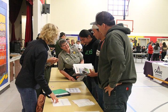 Students discuss future employment opportunities with the NPS' science and resource management department at the Grand Canyon School job fair April 10. (Erin Ford/WGCN)