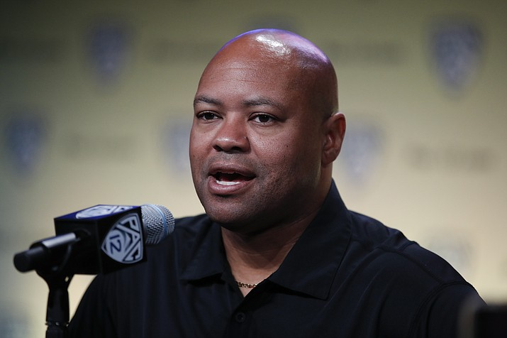 In this July 25, 2018, photo, Stanford head coach David Shaw speaks at the Pac-12 Conference NCAA college football Media Day in Los Angeles. The NCAA's Division I Council meets this week in Indianapolis, and it is expected to vote by Friday, April 19, 2019, on an amendment to the rules regarding graduate transfers and financial aid. If passed the proposal would require a grad transfer to count against a team's scholarship total for two years no matter how much eligibility the player has remaining. Shaw, whose program routinely operates below the major-college maximum of 85 scholarship players, said he would not hesitate to bring in a star-level player as a grad transfer even if it meant having an vacant scholarship the next season. But teams could be less inclined to take that hit with a lesser player. (Jae C. Hong/AP, File)