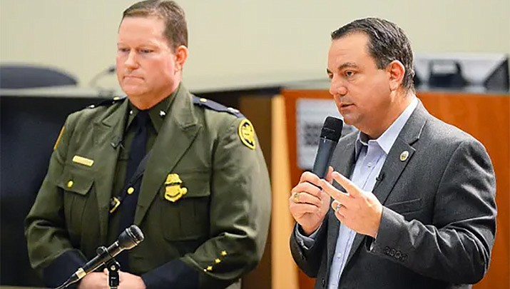 In this March 28, 2019 file photo, Yuma Mayor Doug Nicholls (right) answers a question during a news conference inside Yuma City Council Chambers about the current humanitarian crisis in the border region, due to high volumes of illegal migrant crossings in Yuma. U.S. Border Patrol Deputy Chief Patrol Agent for the Yuma sector, Carl Landrum, is on the left. (Randy Hoeft/Associated Press)