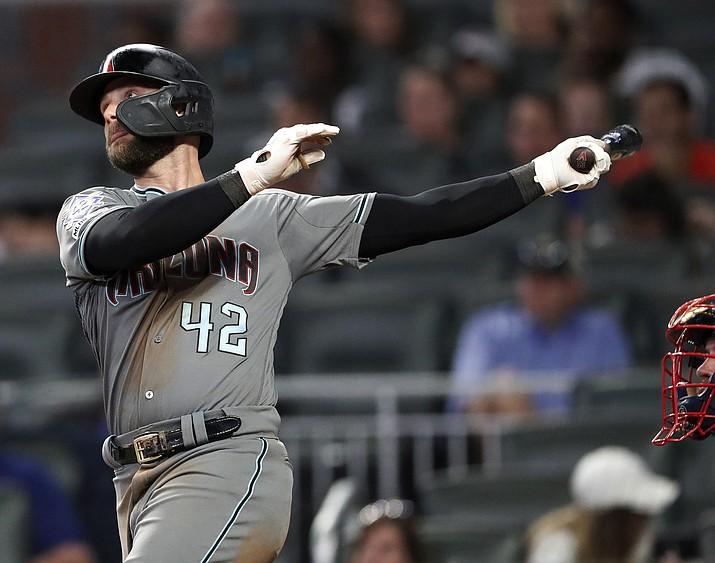Arizona Diamondbacks' Christian Walker (53) follows through on a solo-home run in the ninth inning of a baseball game against the Atlanta Braves, Tuesday, April 16, 2019, in Atlanta. (John Bazemore/AP)