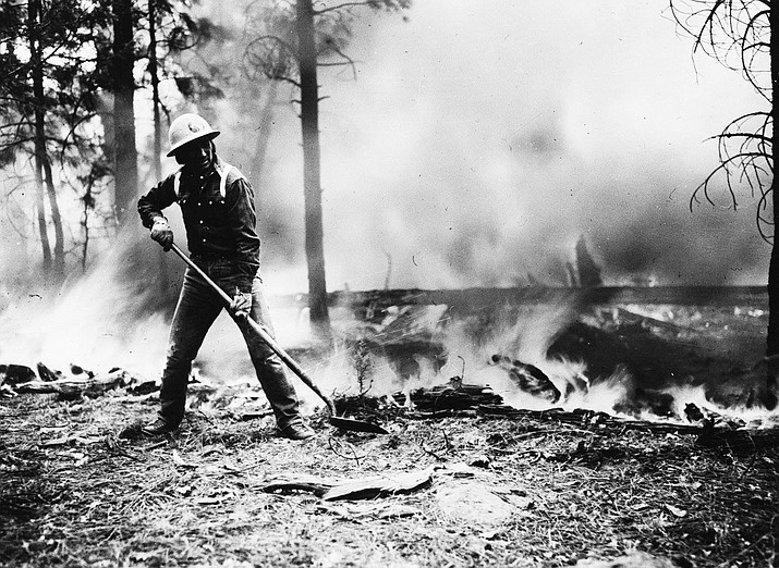 A firefighter works to suppress a wildfire during the Santo Domingo Fire in June 1956. (Photo/USFS, Kaibab National Forest and Apache Sitgreaves National Forest)